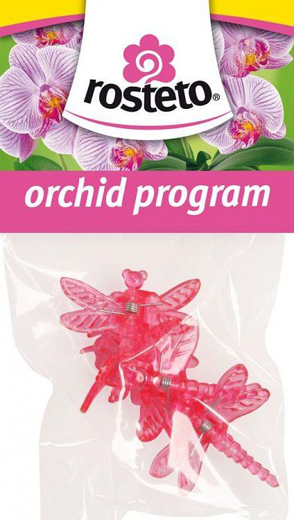 Klips Vážka Rosteto - 4 ks červený Popis:Dekorativní klipsy ve tvaru vážky slouží k uchycení květního stvolu orchidejí k opěrné tyčce. Jsou balené po 4 ks v igelitovém sáčku s EURO závěsem - pro možnost zavěšení na stojan.Materiál:plastBarva:červená (růžová)